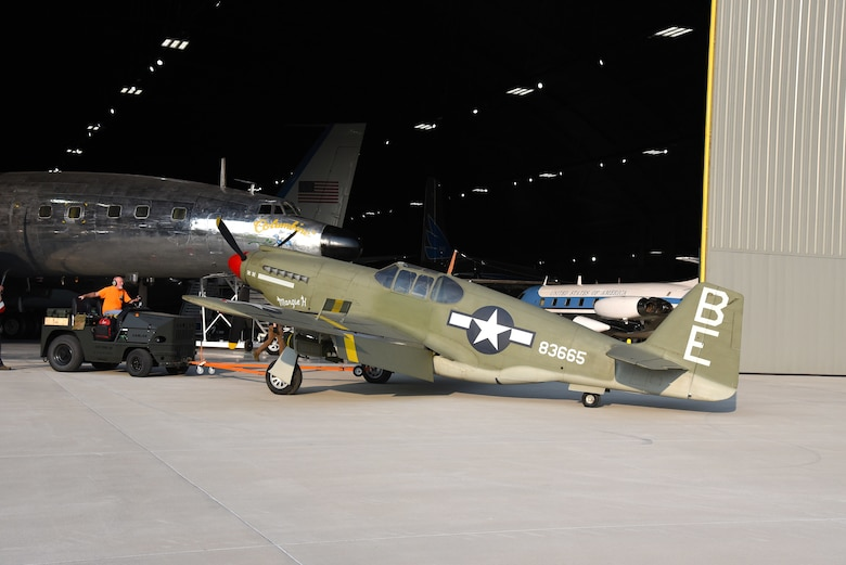 Roger Brigner, a museum restoration specialist at the National Museum of the U.S. Air Force, moves the North American A-36A Apache back toward the WWII Gallery on Aug. 13, 2018. Several WWII era aircraft were temporarily placed throughout the museum to provide adequate space for the Memphis Belle exhibit opening events. (U.S. Air Force photo by Ken LaRock)