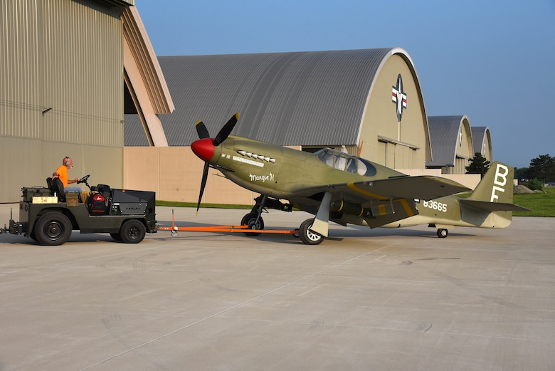Roger Brigner, a museum restoration specialist at the National Museum of the U.S. Air Force, moves the North American A-36A Mustang back toward the WWII Gallery on Aug. 13, 2018. Several WWII era aircraft were temporarily placed throughout the museum to provide adequate space for the Memphis Belle exhibit opening events. (U.S. Air Force photo by Ken LaRock)