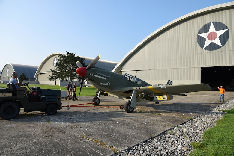 Museum restoration crews move the North American A-36A Mustang back into the WWII Gallery at the National Museum of the U.S. Air Force on Aug. 13, 2018. Several WWII era aircraft were temporarily placed throughout the museum to provide adequate space for the Memphis Belle exhibit opening events. (U.S. Air Force photo by Ken LaRock)