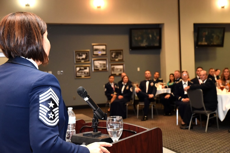 Chief Master Sgt. JoAnne Bass, 2nd Air Force command chief, congratulates Goodfellow senior noncommissioned officer inductees while she gives a speech during the ceremony at the Event Center on Goodfellow Air Force Base, Texas, Aug. 10, 2018. Bass, a former 17th Training Wing command chief, spoke on winning, in their careers and for their Airmen who would be looking up to them even more now that they have joined the ranks of senior NCOs. (U.S. Air Force photo by Airman 1st Class Seraiah Hines/Released)