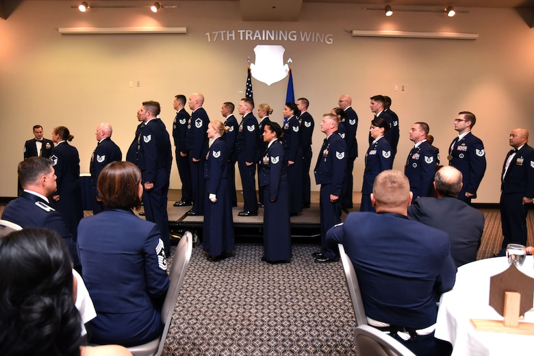 Goodfellow senior noncommissioned officer inductees listen and respond to the senior NCO charge read by Chief Master Sgt. Lavor Kirkpatrick, 17th Training Wing command chief, at the Event Center on Goodfellow Air Force Base, Texas, Aug. 10, 2018. The charge reminds the inductees of the responsibilities that they are taking on in this new position of leadership. (U.S. Air Force photo by Airman 1st Class Seraiah Hines/Released)