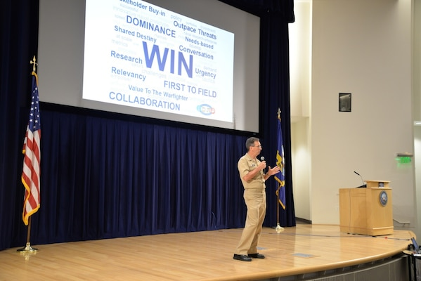 Chief of Naval Research Rear Adm. David Hahn speaks to representatives of the Naval Research and Development Establishment at a collaboration forum on July 31, 2018, at Naval Surface Warfare Center, Carderock Division in West Bethesda, Md. (U.S. Navy photo by Kelley Stirling/Released).