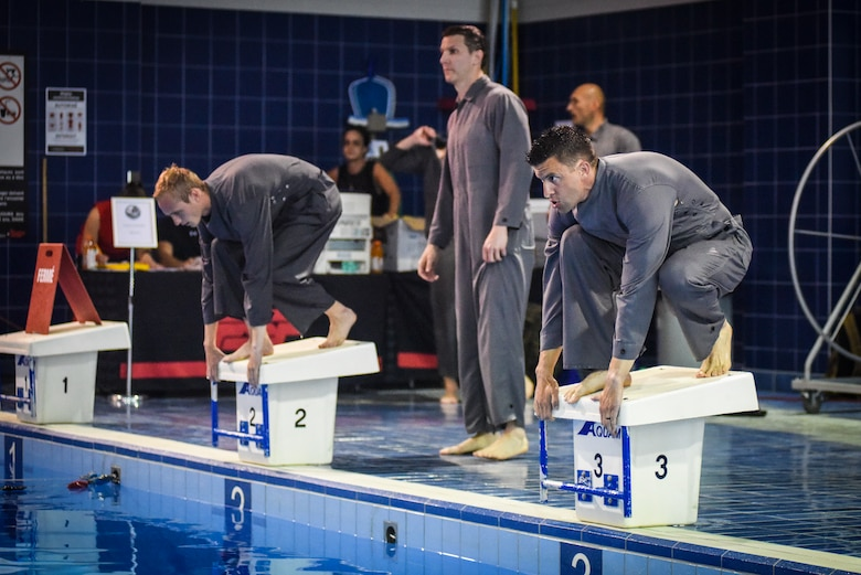 Capt. Sterling Broadhead prepares to compete in a swimming obstacle course during the 2018 Interallied Confederation of Reserve Officers Military Skills Competition in Quebec City, Canada, last week