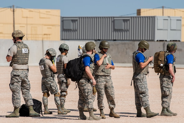Airmen get geared up for the Emergency Medical Technician Rodeo at Melrose Air Force Range, N.M., Aug. 8, 2018. A total of 21 Air Force bases from around the world visited MAFR and Cannon Air Force Base, N.M., to participate in the EMT Rodeo, giving the technicians a wide assortment of scenarios to test their knowledge and training in the medical field. (U.S. Air Force photo by Airman 1st Class Gage Adison Daniel)