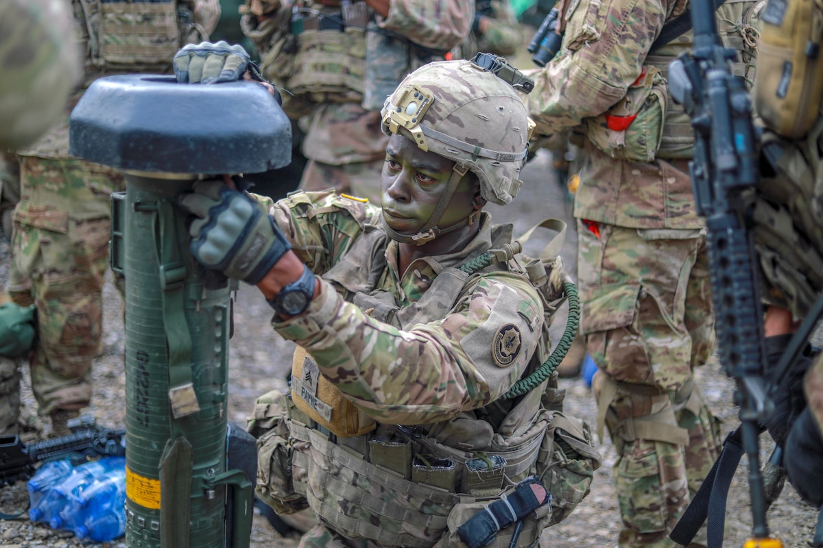 A soldier tests some military equipment.