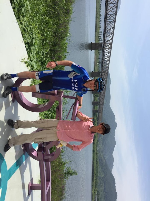 Maj. Anthony Bares, a former 28th Bomb Wing Inspector General office inspector, stands next to a sculpture of a bicycle and its creator in South Korea on May 25, 2018. Bares embarked on a four-day bicycle ride across the South Korea, following the Four Rivers Trail, which almost spans the entire length of the country. (Courtesy photo)