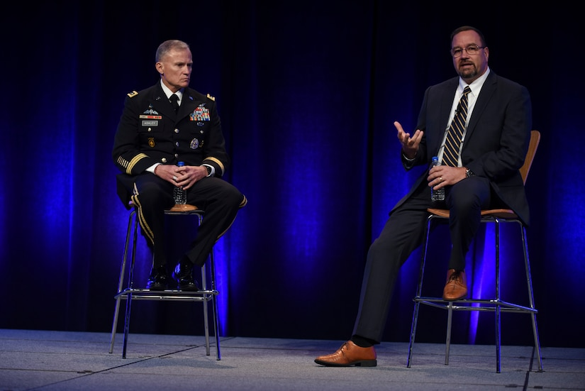 DIA Director Lt. Gen. Robert Ashley, left, and Chief Information Officer Jack Gumtow participate in a question and answer session during the 2018 DoDIIS Worldwide Conference August, 13, 2018, in Omaha, Nebraska.