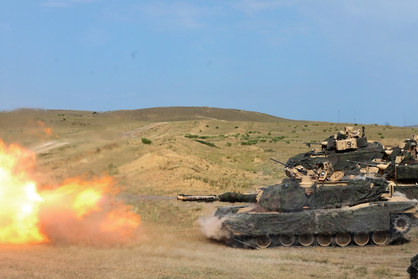 Soldiers fire the M1A2 Abrams tank main battle gun.