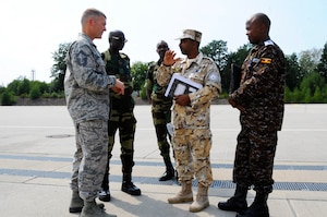 U.S. Air Force Senior Master Sgt. Ronald Robinette, Leaders Production Superintendent, assigned to 86th Air Maintenance Squadron, converses with participants of African Partnership Flight, hosted by U.S. Air Forces Africa and co-hosted by Mauritania and Senegal at Ramstein Air Base, Germany, Aug. 7, 2018. The APF program is Air Forces in Africa's premier security cooperation program with African partner nations to improve professional military aviation knowledge and skills. (U.S. Army photo by Spc. Craig Jensen)
