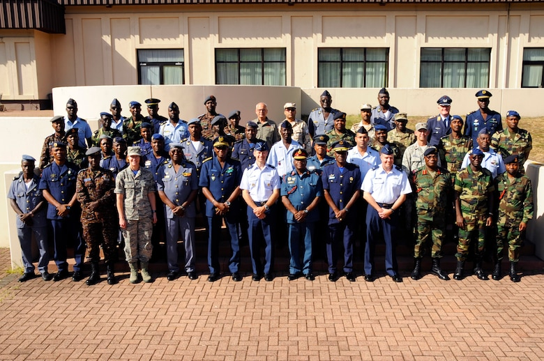 Participants from seven different African partner nations and U.S. Service Members, pose for a photo during African Partnership Flight, hosted by U.S. Air Forces Africa and co-hosted by Mauritania and Senegal at Ramstein Air Base, Germany, Aug. 9, 2018. The APF program is Air Forces in Africa's premier security cooperation program with African partner nations to improve professional military aviation knowledge and skills. (U.S. Army photo by Spc. Craig Jensen)