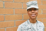 Staff Sgt. Psalmbrea Noel Doss, a personnel specialist with the 194th Force Support Squadron assigned to the Washington Air National Guard, poses for a photo July 18, 2018, at Camp Murray, Wash. Doss heard about the Air National Guard through her mother, who was also once a personnel specialist in the Air Force.