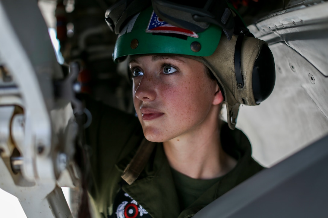 Lance Cpl. Savannah Nickell, a Marine Fighter Attack Squadron 122 airframes mechanic, performs routine maintenance on an F-35 Lightning II during Exercise Northern Lightning at Volk Field Counterland Training Center, Camp Douglas, Wis. Aug. 13.