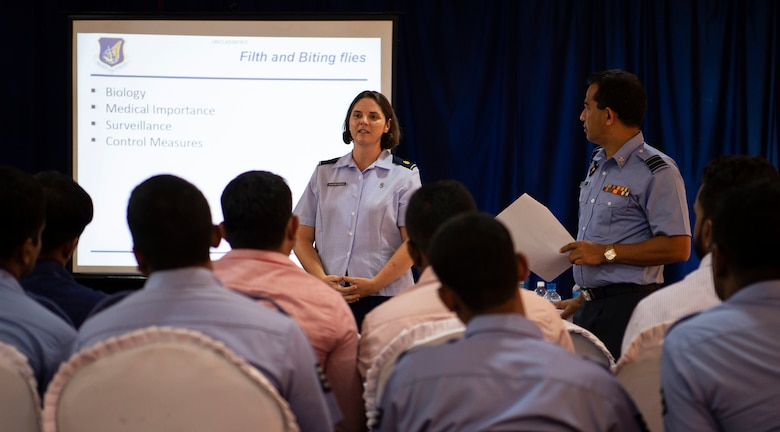 U.S. Air Force Maj. Vicki Charbonneau, 15th Aerospace Medicine Squadron public health officer, briefs a group of civilian public health officials, entomologists, Sri Lankan military doctors, and military public health officials about the importance of capturing insects during an exchange for Pacific Angel (PAC ANGEL) 18-4, in Anuradhapura, Sri Lanka, Aug. 9, 2018. PAC ANGEL 18 fosters partnerships though multilateral humanitarian assistance and civil military operations, which promote regional cooperation and interoperability. (U.S. Air Force photo by Tech. Sgt. Heather Redman)