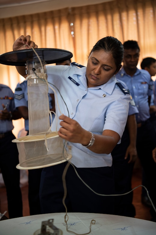 U.S. Air Force Capt. Caroline Brooks, 18th Aerospace Medicine Squadron medical entomologist, builds a mosquito trap during an exchange for Pacific Angel (PAC ANGEL) 18-4, in Anuradhapura, Sri Lanka, Aug. 9, 2018. PAC ANGEL 18 fosters partnerships though multilateral humanitarian assistance and civil military operations, which promote regional cooperation and interoperability. (U.S. Air Force photo by Tech. Sgt. Heather Redman)