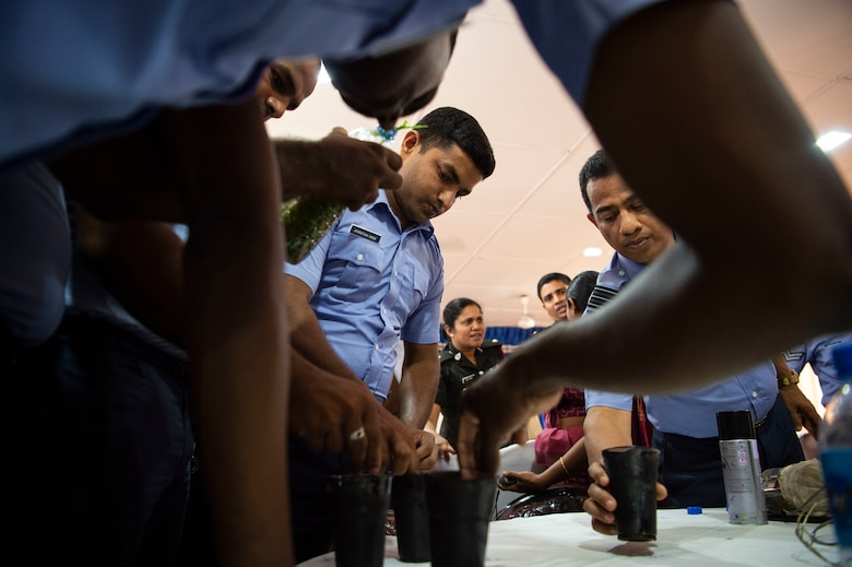 Sri Lankan civilian public health officials, entomologists, military doctors, and military public health officials build mosquito and tick traps during an exchange for Pacific Angel 18-4, in Anuradhapura, Sri Lanka, Aug. 9, 2018. Through PAC ANGEL 18, the U.S. military strengthens its relationships with other nations' through mutually beneficial activities to include humanitarian assistance and civil military operations, which promote regional cooperation and interoperability. (U.S. Air Force photo by Tech. Sgt. Heather Redman)