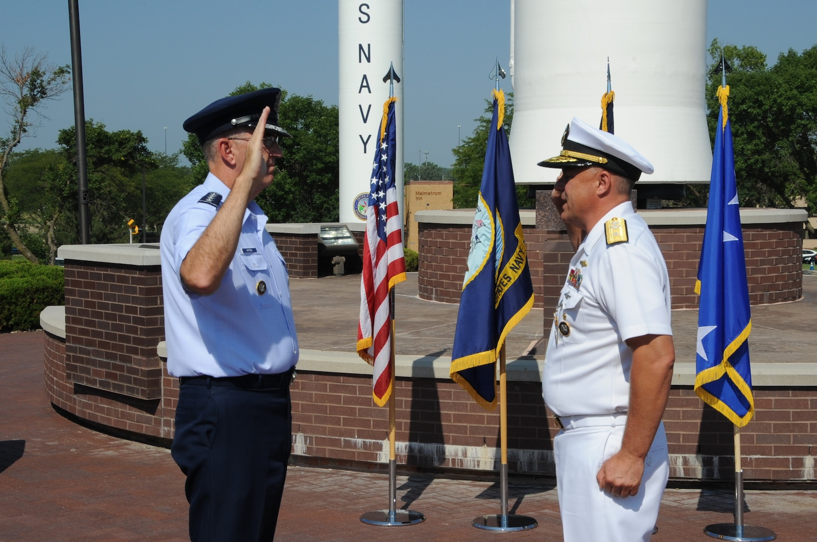 U.S. Air Force Gen. John E. Hyten, commander of U.S. Strategic Command (USSTRATCOM), reaffirms the oath of office to U.S. Navy Rear Adm. John Spencer during his promotion ceremony on the missile deck at USSTRATCOM headquarters on Offutt Air Force Base, Neb., Aug. 9, 2018. Spencer is the executive assistant to Gen. Hyten. His next assignment will be the director of Nuclear Support Directorate, Defense Threat Reduction Agency at Ft. Belvoir, Va.  USSTRATCOM has global responsibilities assigned through the Unified Command Plan that include strategic deterrence, nuclear operations, space operations, joint electromagnetic spectrum operations, global strike, missile defense, and analysis and targeting.