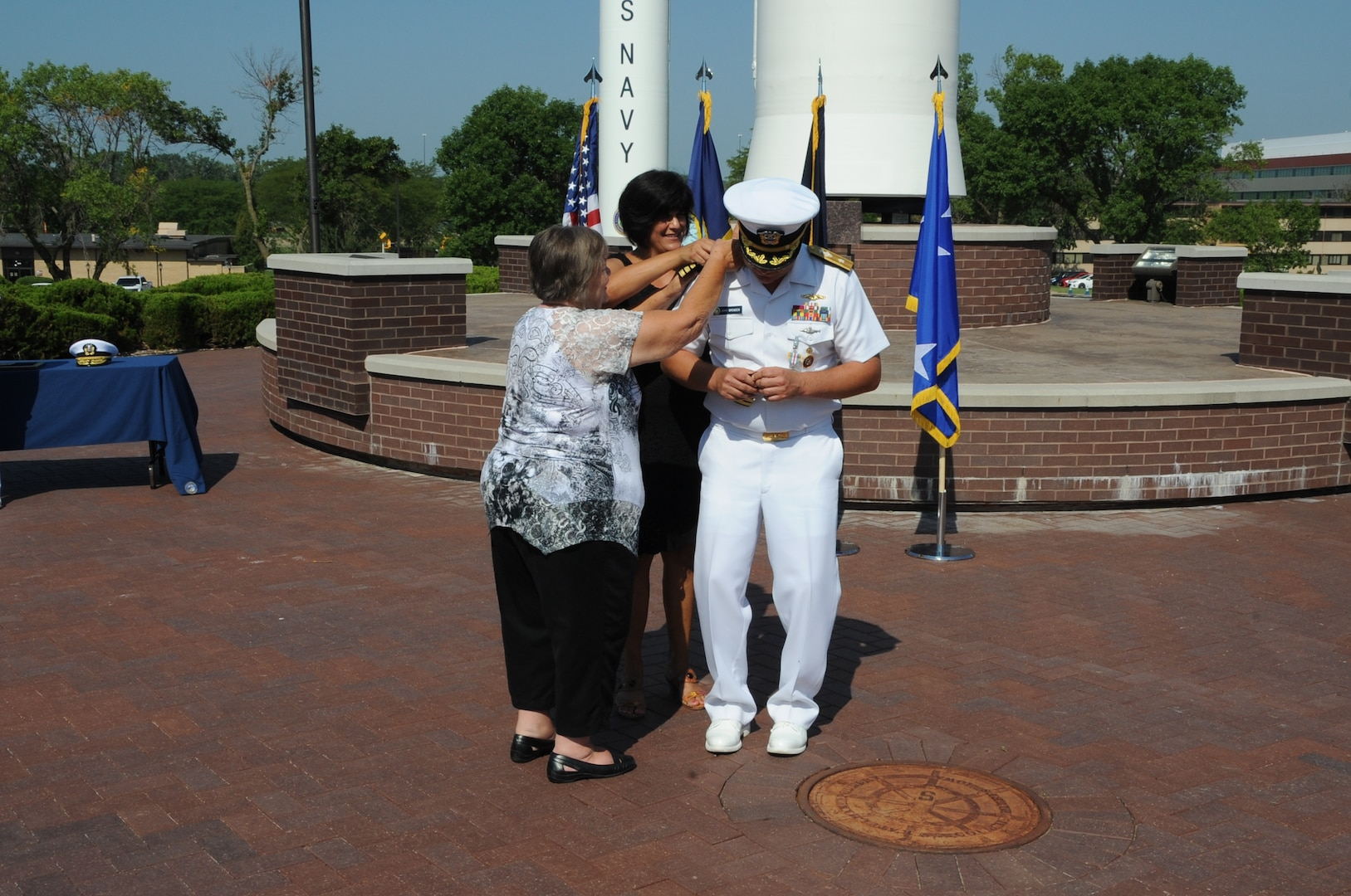 U.S. Navy Rear Adm. John Spencer's wife and his mother pin shoulder boards during his promotion ceremony on the missile deck at U.S. Strategic Command (USSTRATCOM) headquarters on Offutt Air Force Base, Neb., Aug. 9, 2018. Spencer is the executive assistant to U.S. Air Force Gen. John Hyten, commander of USSTRATCOM. His next assignment will be the director of Nuclear Support Directorate, Defense Threat Reduction Agency at Ft. Belvoir, Va.  USSTRATCOM has global responsibilities assigned through the Unified Command Plan that include strategic deterrence, nuclear operations, space operations, joint electromagnetic spectrum operations, global strike, missile defense, and analysis and targeting.