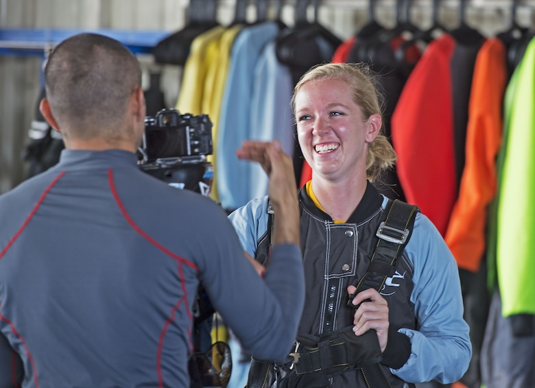 U.S. Airman 1st Class Elizabeth Coleman, 20th Equipment Maintenance Squadron munition systems specialist smiles during an on-camera interview before going skydiving in Chester, S.C., Aug. 11, 2018.