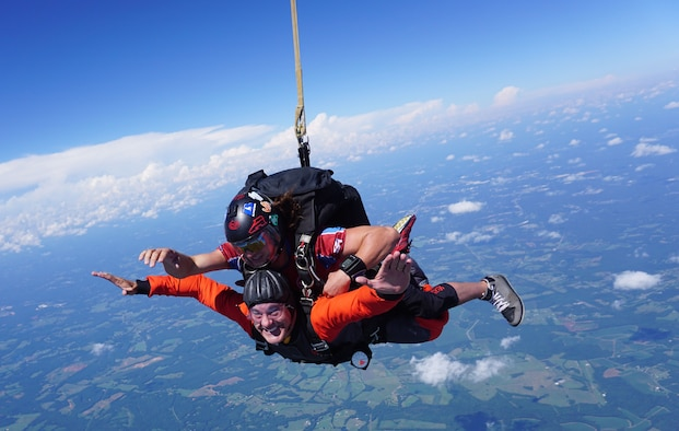 U.S. Air Force Chaplain (Capt.) James Finley, 20th Fighter Wing chaplain, smiles at the camera as he falls from 15,000 feet Chester, S.C., Aug. 11, 2018.