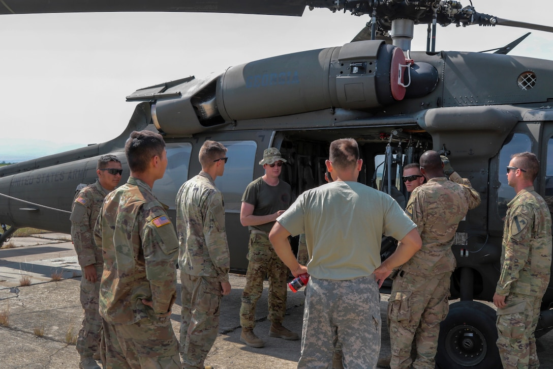 An Army helicopter pilot conducts helicopter orientation for soldiers.
