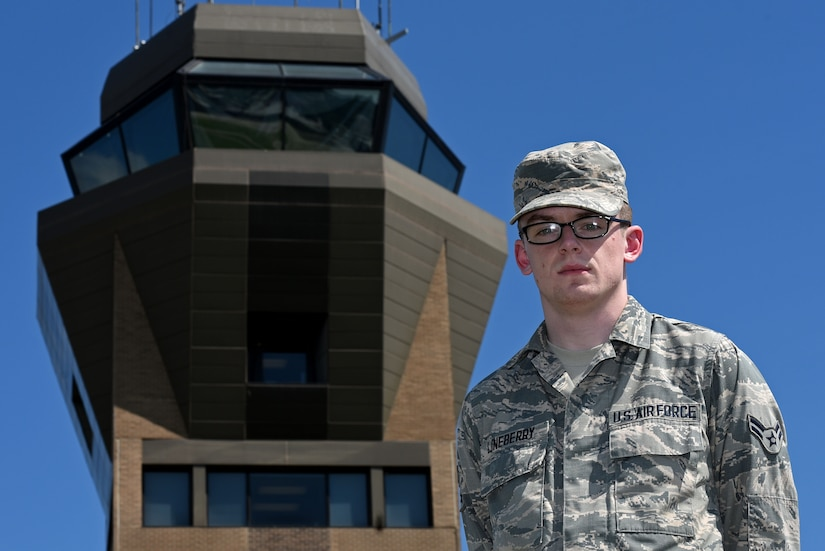 U.S. Air Force Airman 1st Class Austin Lineberry, 20th Operations Support Squadron air traffic control apprentice, stands in front of the air traffic control tower at Shaw Air Force Base, S.C., Aug. 10, 2018.