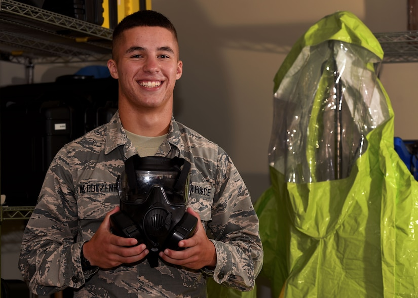 U.S. Air Force Airman Jacob Mlodozeniec, 20th Aerospace Medicine Squadron bioenvironmental engineer apprentice, holds a gas mask at Shaw Air Force Base, S.C., Aug. 10, 2018.