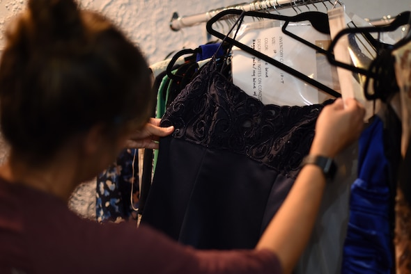 A patron of Operation Ball Gown, a free gown loan service, picks out dresses at Kirtland Air Force Base, N.M., August 13, 2018. The service provides Department of Defense ID card holders dresses for both military and non military related functions. (U.S. Air Force photo by Senior Airman Eli Chevalier)