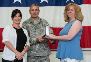 Lynn Amidon (right) is recognized by Col. Tim Wollmuth, 934th Airlift Wing vice commander, and Dina Landsberger for her two years service as director of the 934th Airlift Wing Key Spouse program. Ms. Tami DiGiovanni will take over as the new director. (Air Force Photo/Tech. Sgt. Amber Jacobs)