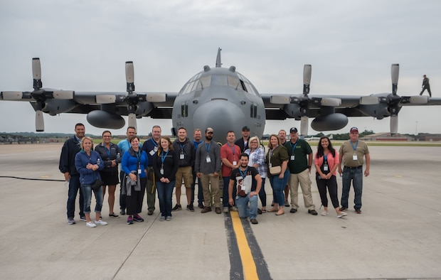 Employers pose in front of the C-130 they would fly on during Employers Day Aug. 4. (Air Force Photo/Paul Zadach)