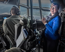 Lindsay Hammond from KL Discovery enjoys the view from the C-130 cockpit. (Air Force Photo/Paul Zadach)