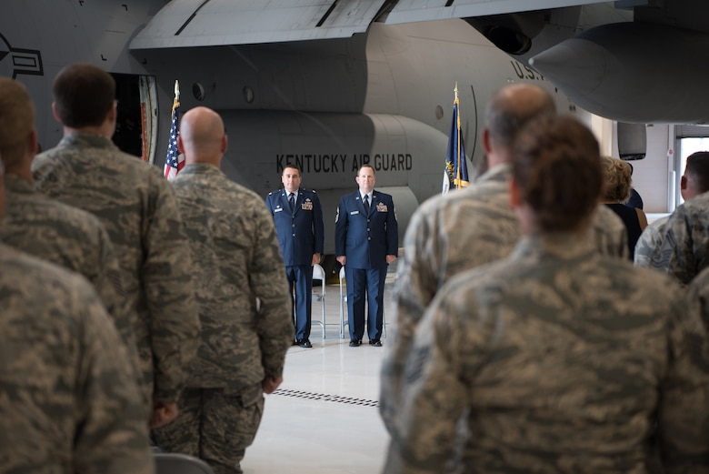 Maj. Jerry Zollman (left), commander of the 123rd Maintenance Squadron, and Chief Master Sgt. Chris Burgin, superintendent of the 123rd Maintenance Group, stand as Burgin's retirement citation is read at a ceremony at the Kentucky Air National Guard base in Louisville, Ky., on July 14, 2018. Burgin was the first chief master sergeant selected to fill the newly created superintendent position for the 123rd Maintenance Group. (U.S. Air National Guard photo by Master Sgt. Phil Speck)