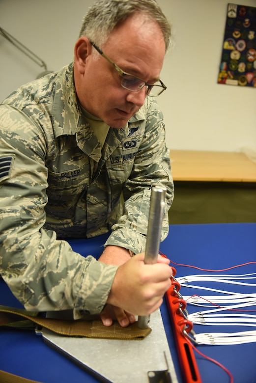 Staff Sgt. Stephen Falker, an aircrew flight equipment technicians with the 193rd Special Operations Support Squadron, Middletown, Pennsylvania, Pennsylvania Air National Guard, builds a Low-Profile Parachute from scratch Aug. 9, 2018. The new parachutes replaced the old ones, which were originally constructed in the 1980's. (U.S. Air National Guard photo by Senior Airman Julia Sorber/Released)