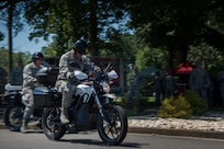 U.S. Air Force Airmen test drive motorcycles during the Vehicle Transformation and Acquisition Council conference at Joint Base Langley-Eustis, Virginia, Aug. 8, 2018.