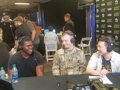 Soldier and gamers conducting an interview for Twitch TV