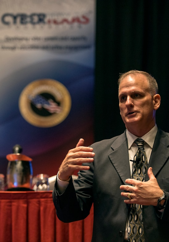 Robert Cole, Air Forces Cyber executive director, speaks to attendees at the CyberTexas Conference in San Antonio, Texas, Aug. 14, 2018. The conference was hosted to develop the next generations of cyber professionals. (U.S. Air Force photo by Tech. Sgt. R.J. Biermann)
