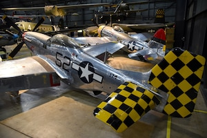 View of the North American P-51D Mustang and the Republic P-47D (Bubble Canopy Version) in the WWII Gallery at the National Museum of the U.S. Air Force. (U.S. Air Force photo by Ken LaRock)