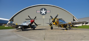 A view of the North American P-51D Mustang and the Republic P-47D (Bubble Canopy Version) before restoration crews at the National Museum of the U.S. Air Force moved the aircraft into the WWII Gallery on Aug. 14, 2018. Several WWII era aircraft on display were temporarily placed throughout the museum to provide adequate space for the Memphis Belle exhibit opening events. (U.S. Air Force photo by Ken LaRock)