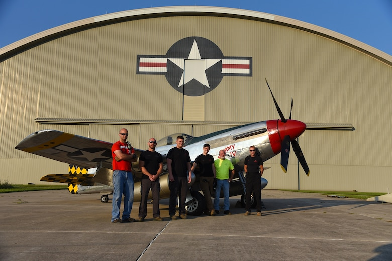 Museum restoration specialists(from left to right) Adam Naber, Chase Meredith, Nick Almeter, Casey Simmons, Roger Brigner, and Brian Lindamood pose for a photo with the North American P-51D Mustang at the National Museum of the U.S. Air Force on Aug. 14, 2018. They are well versed in a variety of skills ranging from machine and woodworking expertise to precision craftsmanship in sheet metal and painting. Their knowledge of aircraft spans years of technology -- from World War I fabric covered aircraft to the elite fighters of today's Air Force. (U.S. Air Force photo by Ken LaRock)
