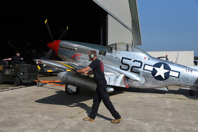 Museum restoration crews move the North American P-51D Mustang back into the WWII Gallery at the National Museum of the U.S. Air Force on Aug. 14, 2018. Several WWII era aircraft were temporarily placed throughout the museum to provide adequate space for the Memphis Belle exhibit opening events. (U.S. Air Force photo by Ken LaRock)