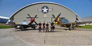 Museum restoration specialists(from left to right) Nick Almeter, Casey Simmons, Chase Meredith, and Brian Lindamood pose for a photo with the North American P-51D Mustang and the Republic P-47D (Bubble Canopy Version) at the National Museum of the U.S. Air Force on Aug. 14, 2018. They are well versed in a variety of skills ranging from machine and woodworking expertise to precision craftsmanship in sheet metal and painting. Their knowledge of aircraft spans years of technology -- from World War I fabric covered aircraft to the elite fighters of today's Air Force. (U.S. Air Force photo by Ken LaRock)