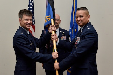 U.S. Air Force Col. Thomas Coakley, 17th Training Group commander, takes the guideon from Lt. Col. Abraham Salomon, 17th Training Squadron outgoing commander, during the 17th TRSS Change of Command in the Event Center on Goodfellow Air Force Base, Texas, August 14, 2018. Salomon served as the 17th TRSS commander from 2016 to 2018. (U.S. Air Force photo by Senior Airman Randall Moose/Released)