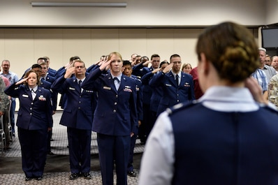 Members of the 17th Training Support Squadron salute U.S. Air Force Lt. Col. Amber Saldaña, 17th TRSS commander, during the 17th TRSS Change of Command in the Event Center on Goodfellow Air Force Base, Texas, August 14, 2018. The change of command ceremony is a time honored military tradition that signifies the orderly transfer of authority. (U.S. Air Force photo by Senior Airman Randall Moose/Released)