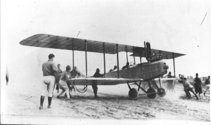 Maj. George E.A. Reinburg (front seat) and Mr. William H. Couch (civilian instructor pilot) prepare to take off on the first flight from Scott Field on Sept. 2, 1917