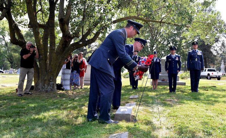 From left to right, 56 Squadron Leader David Hockley and 55th Wing Commander Col. Michael Manion place their respective country's wreaths on the gravesite of Lt. Jarvis Offutt at Forest Lawn Cemetery in Omaha, Nebraska Aug. 13, 2018. A ceremony was held during the 2018 Offutt Air Force Base air and space show to honor Offutt who the base is named after. Offutt was the first Omaha native to die in WWI when his plane was shot down over France 100 years ago while serving in the 56 Squadron. (U.S. Air Force photo by Josh Plueger)