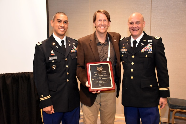 Present and Past USAREC Command Psychologists, Lt. Col. Joseph H. Afanador (left) and Lt. Col. Craig M. Jenkins (right) receive the 2018 Julius E. Uhlaner Award from Society for Military Psychology Division 19 President retired USAF Lt. Col. Mark Staal during the #APA2018 Convention in San Francisco, Califorinia. The Office of Command Psychologist was recognized with the Julius E. Uhlaner Award for their efforts to improve the effectiveness of the assessment for Soldiers being considered for or assigned to recruiting duty.