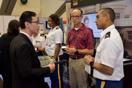 United States Army Recruiting Command's Command Psychologist, Lt. Col. Joseph H. Afanador and Greg Florey, conventions exhibitor, National Conventions Division speaking with an American Psychological Association 2018 Convention attendee about the benefits of a psychology career in the Army. Afanador and Florey were on hand with members of the San Francisco Medical Recruiting Station to explain the advantages and opportunities of careers in Army Medicine. For more information on the Army's more than 90 medical specialties go to healthcare.goarmy.com.