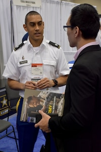 Lt. Col. Joseph H. Afanador, United States Army Recruiting Command, command psychologist speaks with an attendee of the American Psychological Association 2018 Convention at the Moscone Center in San Francisco, California on August 9. Afanador was on hand with members of the San Francisco Medical Recruiting Station to explain the benefits and opportunities of a career in Army Medicine. For more information on the Army's more than 90 medical specialties go to healthcare.goarmy.com.