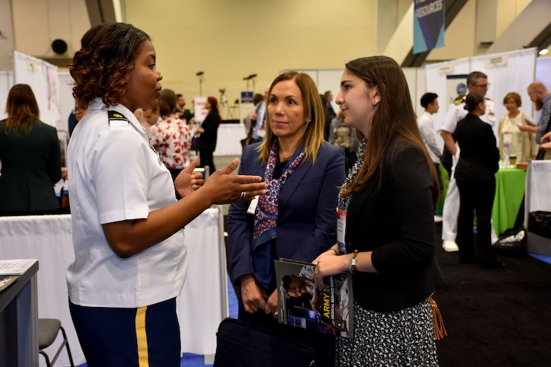 Maj. Lakishia M. Simmons, San Francisco Medical Recruiting Station officer-in-charge, speaks with a convention attendee and her parent at the American Psychological Association 2018 Convention held at the Moscone Center in San Francisco, California on August 9. Simmons was on hand with her healthcare recruiting team to explain the benefits and opportunities of a career in Army Medicine. For more information on the Army's more than 90 medical specialties go to healthcare.goarmy.com.