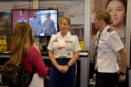 Staff Sgt. Shanna M. Rodriguez, health care recruiter with the San Francisco Medical Recruiting Station, and Capt. Emily Burris, clinical psychology resident with Brooke Army Medical Center, speak with an attendee of the American Psychological Association 2018 Convention at the Moscone Center in San Francisco, California on August 9. Rodriguez and Burris were on hand with explain the benefits and opportunities of a career in Army Medicine. For more information on the Army's more than 90 medical specialties go to healthcare.goarmy.com.