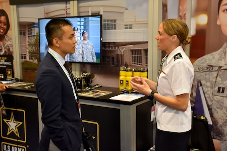 Capt. Emily Burris, clinical psychology resident with Brooke Army Medical Center, speaks with an attendee of the American Psychological Association 2018 Convention at the Moscone Center in San Francisco, California on August 9. Burris was on hand with Soldiers from the San Francisco Medical Recruiting Station to explain the benefits and opportunities of a career in Army Medicine. For more information on the Army's more than 90 medical specialties go to healthcare.goarmy.com.